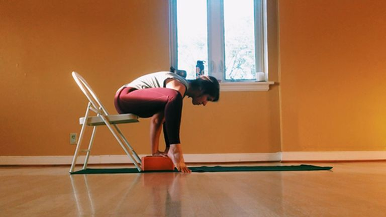 5 Yoga Poses You Can Do From the Comfort of Your Chair