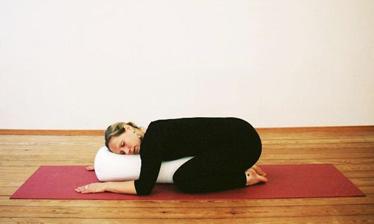 4 Ways To Bring Restorative Yoga To Your Home