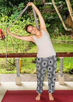 Side stretch with yoga strap