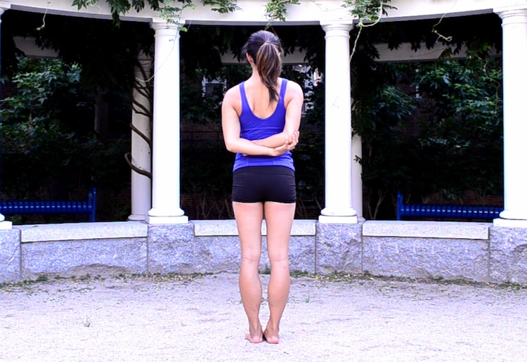 tadasana - opposite elbows behind back